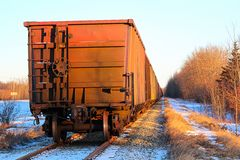 Free A Grain Train Car Waiting On A Track Royalty Free Stock Photo - 108903335