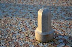 Free A Granite Decorative Bollard On A Square Of Bright Granite Color Around A Granite Bar In A Paving Pillar Stock Image - 177815991