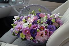Free A Gray Wicker Basket With Pink White And Purple Flowers Sits On The Front Seat Of A Luxury Stock Photo - 123687340