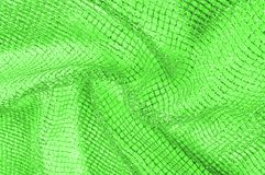 Free A Green Silver Mesh Fabric, With A Woven Metallic Thread. Enjoy Royalty Free Stock Photos - 122907378