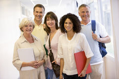 Free A Group Of Adult Students With Backpacks Standing Stock Photo - 7035360