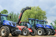 Free A Group Of Blue Tractors Parked Up Royalty Free Stock Photo - 96035105