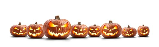 Free A Group Of Eight Lit Spooky Halloween Pumpkins, Jack O Lantern With Evil Face And Eyes Royalty Free Stock Photos - 196394928