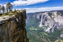 A Group Of People Visiting Taft Point, A Popular Vista Point; El Capitan, Yosemite Valley And Merced River Visible On The Right; Royalty Free Stock Image