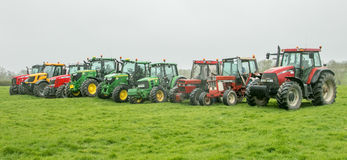Free A Group Of Tractors Parked Up Stock Photos - 90600853