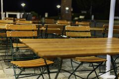 Free A Group Of Wooden Patio Furniture On The Terrace Of A Restaurant Royalty Free Stock Image - 178321786