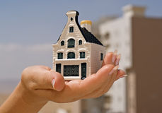 A Hand Bolding A Toy House. Royalty Free Stock Images