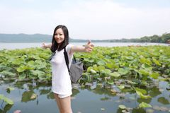 A Happy Beauty Girl On Hat And Sunglasses Travel In A Summer Garden Lotus Field By A Lake Xihu Hangzhou Royalty Free Stock Image