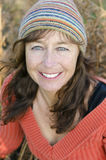 A Happy Smiling Mature Woman With Freckles. Stock Photo
