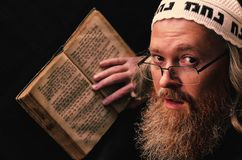 Free A Hasidic Jew Reads Siddur. Religious Orthodox Jew With A Red Beard And With Pace In A White Bale Praying. Closeup Stock Photo - 160127520