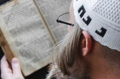 Free A Hasidic Jew Reads Siddur. Religious Orthodox Jew With A Red Beard And With Pace In A White Bale Praying. Closeup Stock Images - 160127524