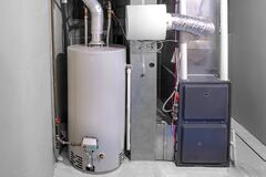 Free A Home High Efficiency Furnace With A Residential Gas Water Heater & Humidifier Stock Photo - 197107410