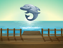 Free A Jumping Dolphin And Sea Port Royalty Free Stock Photos - 33695108