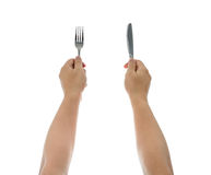 A Knife And Fork Being Held By Man S Hands. Royalty Free Stock Photos