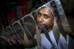 Free A Labor Showing His Cutting Steel Sheet. Stock Images - 105994934