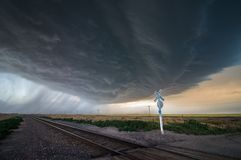 Free A Large Storm Blows In Over A Railroad Crossing, Producing Heavy Rain And Extreme Winds. Royalty Free Stock Image - 151241536