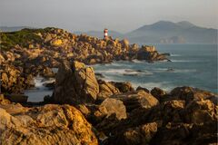 Free A Lighthouse On The Rocks Stock Image - 181586651