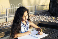A Little Beautiful Girl Draws Heart In Park Royalty Free Stock Images