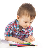 A Little Boy At The Table Draws Stock Image