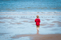 Free A Little Boy Walking Into The Sea Alone Royalty Free Stock Photos - 84072928