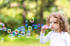 Free A Little Girl Blowing Soap Bubbles, Closeup Portrait Beautiful C Royalty Free Stock Photos - 40434248