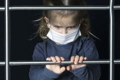 Free A Little Girl In A Mask Climbs The Stairs. Moving Up To Success Stock Photo - 181019540