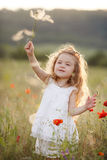 A Little Girl With A Dandelion On A Summer Meadow Royalty Free Stock Photo