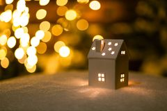 Free A Little House With Stars On The Snow In The Night With Boche Background. Stock Photo - 136595860