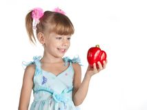 A Little Sweet Girl With A Red Pepper Stock Photography