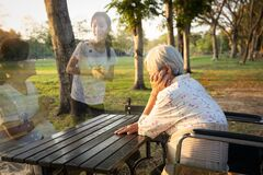 Free A Lonely Senior Woman Is Waiting And Thinking Old Memories Of Her Family That Will Visit Her Again,depressed Elderly People With Royalty Free Stock Photos - 175774868
