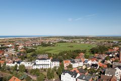 Free A Look From Above The Lighthouse To The Landscape Of The Northern Sea Island Borkum With A Green Floor In The Middle Stock Photography - 125553442