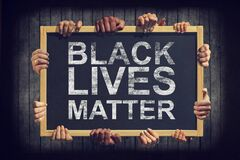 Free A Lot Of Hand Are Holding A Banner With Text BLACK LIVES MATTER On Dark Background. Different People Express One Common Opinion Royalty Free Stock Photography - 186594767