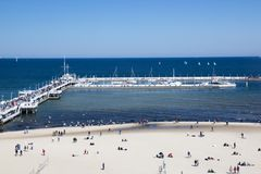 Free A Lot Of People On The Long White Pier Royalty Free Stock Photography - 110554317