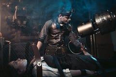A Mad Doctor, A Mechanic, A Designer Creates Himself A Girl. Stock Photos