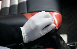 Free A Male Changing Gear Of A Car Wearing Gloves Amid Covid 19 Pandemic. Male Going Back To Work With Protective Gloves. Stock Image - 180179301