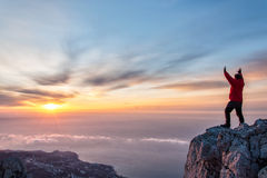 A Man At Mountain Top With Open Arms Royalty Free Stock Images