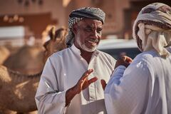 Free A Man Bargaining At A Camel Market Stock Images - 218658234