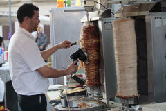 A Man Chops Kebap Slices On A Street Stand Stock Photos