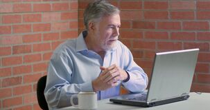 Free A Man Engaged In A Virtual Interview Or Visit With Someone Using The Video Stock Photo - 184744840