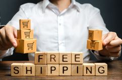 Free A Man Holds Boxes Over The Inscription Free Shipping. Promotions Preferential Terms For Large Customers And Product Groups Stock Image - 159601671