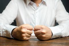 Free A Man Holds His Closed Fists On The Table. The End Of Patience. It Is Impossible To Bear It. An Attack Of Anger, Stress. Stock Photography - 158884972