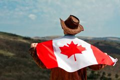 A Man In A Cowboy Hat Take Canadian Flag Stock Images