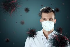 Free A Man In A Mask Protects Himself From Virus Particles Flying In The Air. Coronavirus, COVID-19, Isolation, Quarantine, Pandemic Stock Photo - 178955720