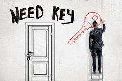 Free A Man In Suit Standing On A Ladder To The Right Of A Locked Door With The Title `Need Key` Above And Drawing A Key On A Stock Photography - 132744452