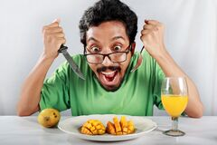Free A Man Is Delighted To See Mouthwatering Mango Desert. Royalty Free Stock Photography - 187996067