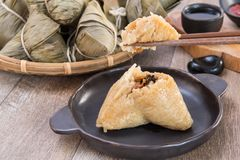 Free A Man Is Going To Eat Zongzi Or Rice Dumpling On Dragon Boat Festival Stock Image - 117120221
