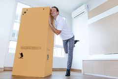 Free A Man Likes A Big Paper Box In The Apartment. Stock Image - 164225051