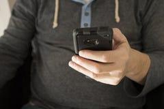 Free A Man Looking At His Phone Royalty Free Stock Photos - 147623578