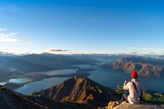 Free A Man Looking At The Beautiful Landscape Of The Mountains And Lake Wanaka. Roys Peak Track, South Island, New Zealand. I Stock Photos - 157469173