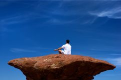 A Man Meditating On A High Rock Royalty Free Stock Image